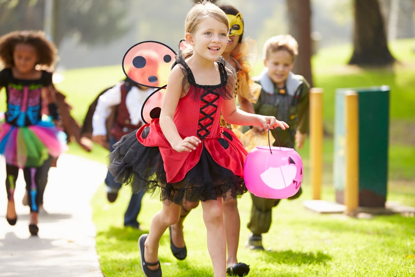 42307388 - children in fancy costume dress going trick or treating